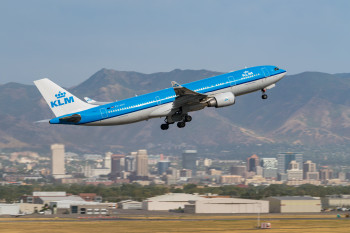 KLM with city and mountains