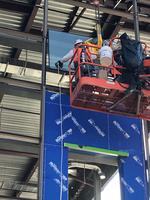 First piece of glass installed on North Concourse March 25 2019